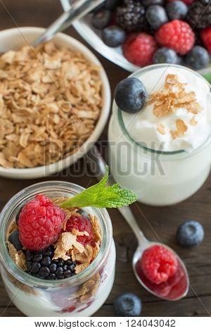 Healthy breakfast with Fresh greek yogurt muesli and berries