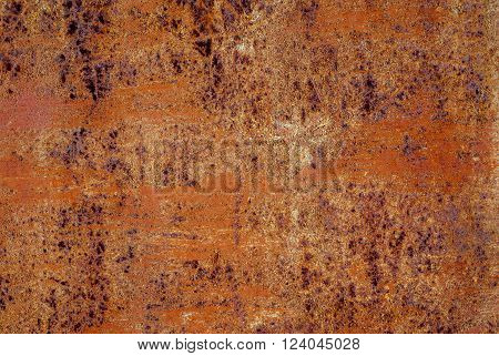 Ferruginous metallic surface with an old paint. Background.