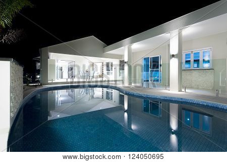 Blue Water Round Swimming Pool With A Hotel