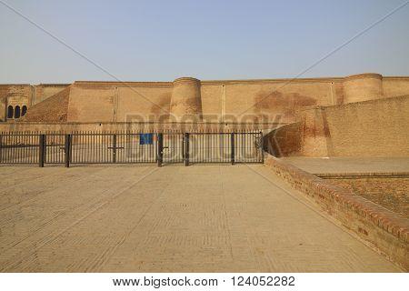 The restored red brick walls and pathways at Bathinda fort, Punjab, India.