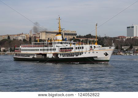 ISTANBUL TURKEY - MARCH 06 2016: Sehir Hatlari ferry passing from European side to Asian side of Istanbul. Sehir Hatlari was established in 1844 and now carry 150000 passengers a day.