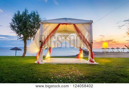 Wedding altar on greek shore at sunrise