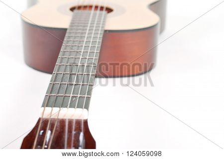 Closeup of an old classical acoustic guitar (shallow DOF selective focus on the strings) with copy space for your text