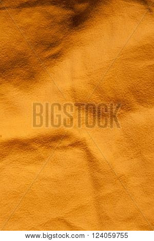Dark yellow background resembling a sand texture (as an abstract retro background)