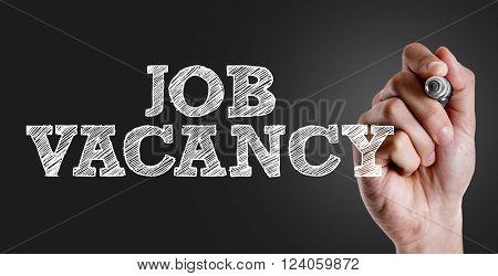 Hand writing the text: Job Vacancy