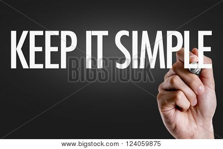 Hand writing the text: Keep It Simple