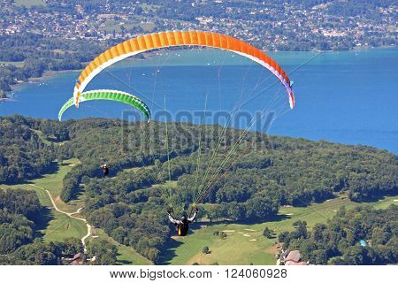 Paragliders flying above Lake Annecy in France ** Note: Soft Focus at 100%, best at smaller sizes