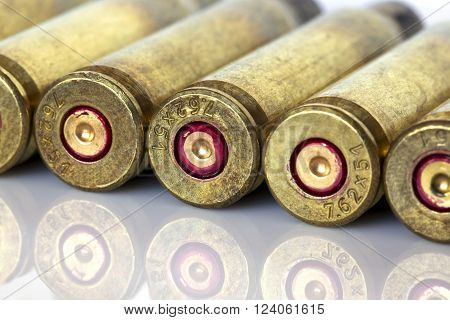 the cartridge cases on a white background