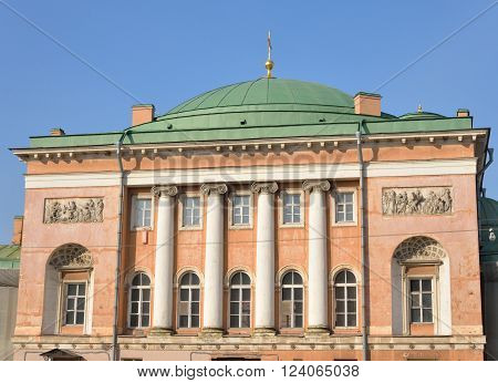 Fragment of Stables yard building in the classical style in the center of St. Petersburg at sunny day Russia.