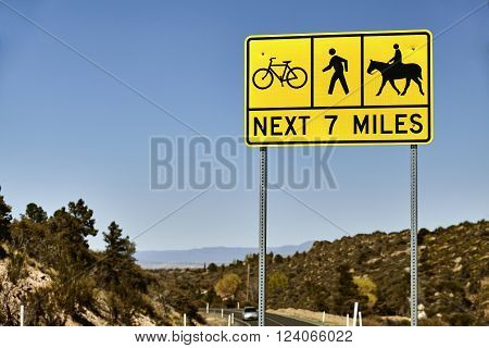 Yellow sign warning motorist of bicyclist pedestrians and equestrians sharing the road