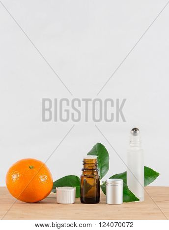 Orange Essential Oil Bottle With Citrus Leaves and Roller Bottle