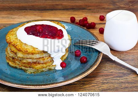 Fried Potato Pancakes with Cranberry Jam. Belarusian and German Cuisine. Studio Photo