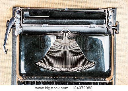 Old typewriter on table. Closeup photo of a vintage typewriter.