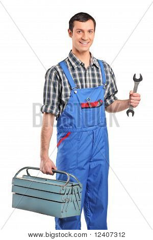 A Repairman In Blue Overall Holding A Toolbox And Wrench