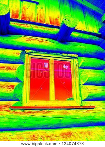 Detail of closed window in cabin wall. Traditional construction of timber house in thermography scan.