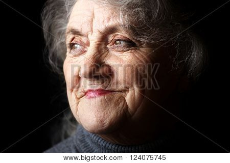 Old granny face on a black background