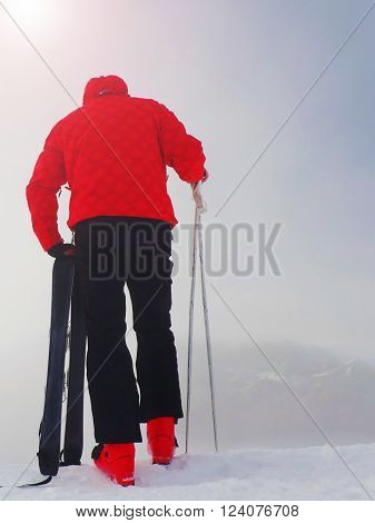 Skier In Red Winter Jacket With  Small Fun Skis Stay In Snow.