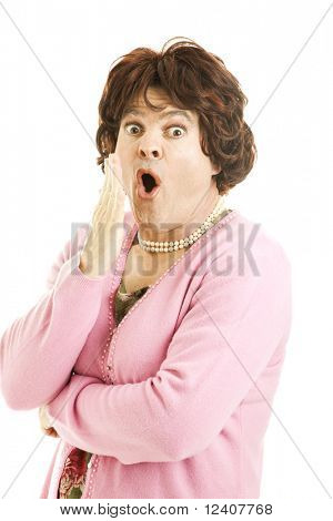 Funny photo of a female impersonator who is shocked. Isolated on white.