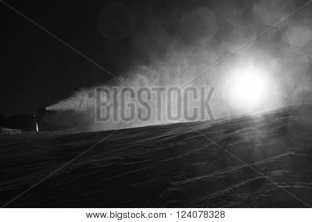 Skier Near A Snow Cannon Making Powder Snow. Alps Ski Resort.