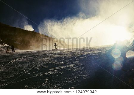 Skier Near A Snow Cannon Making Powder Snow. Alps Ski Resort.