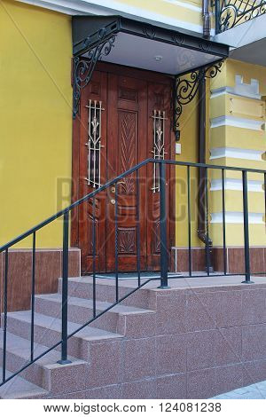 Wooden door with a canopy in a classic style. Architecture