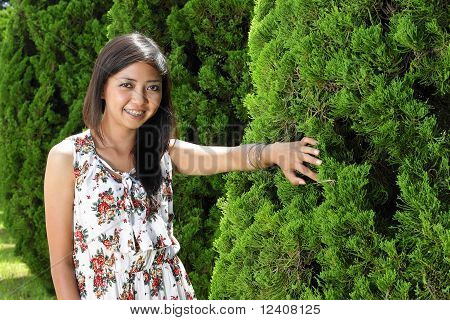 young asian girl smiling outdoor
