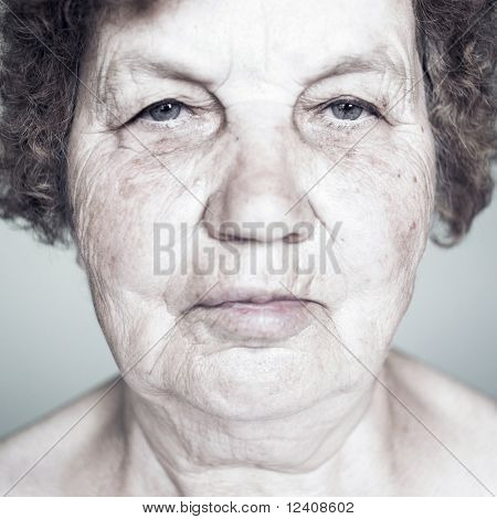 Gracious senior lady portrait on white background