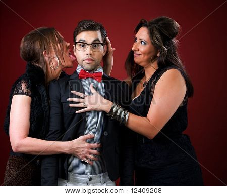 Two Older Women With A Shy Young Man