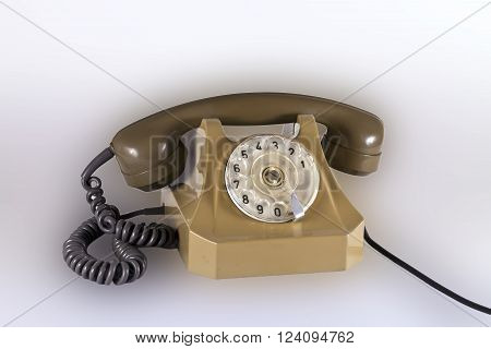 Old plastic telephone with a tube and a wire