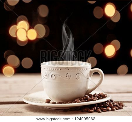 Cup of coffee on table on brown background
