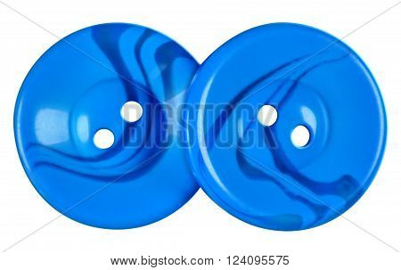 Light blue plastic buttons isolated on white