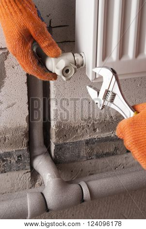 plumber to connect the radiator to the polypropylene pipes
