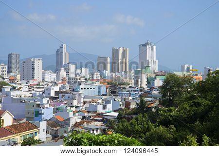 NHA TRANG, VIETNAM - JANUARY 01, 2016: Nha Trang sunny day, the city skyline. Top view of modern houses in Nha Trang, Vietnam