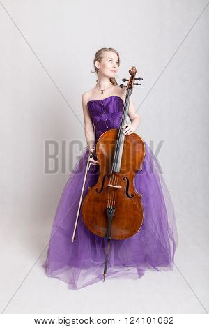 woman in a purple evening dress with cello