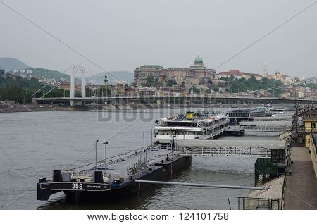 River Danube Embankment, Buda Castle And Bridge On Background. Budapest, Hungary