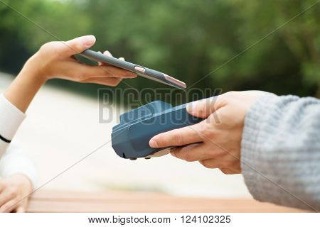Woman pay by NFC on cellphone