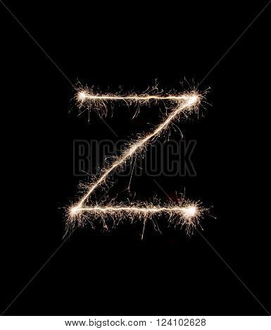 Letter Z drew with spakrs on a black background.