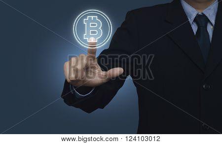 Businessman pressing bitcoin icon on blue background Choosing bitcoin concept