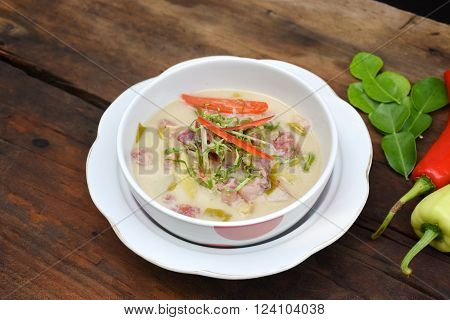 Sour and Sweet curry pickled pork with Thai spices in coconut milk. Moo Som soup of Thai food