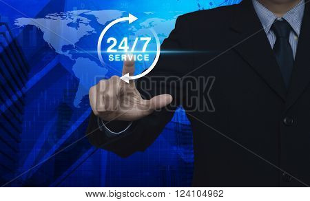 Businessman pressing button 24 hours service icon over map and city tower Full time service concept Elements of this image furnished by NASA