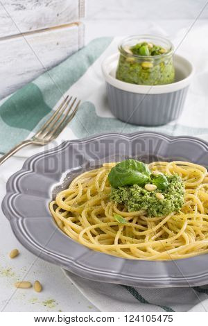 Spaghetti with pesto with pine nuts and parmesan cheese basil