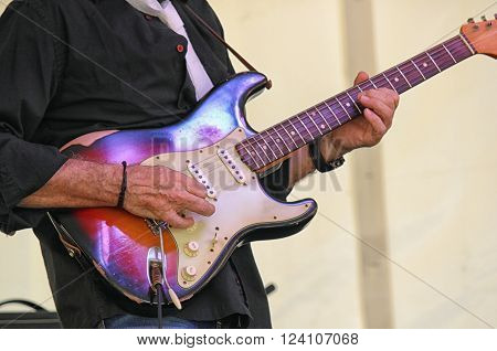 Guitarist playing a live concert in outdoors