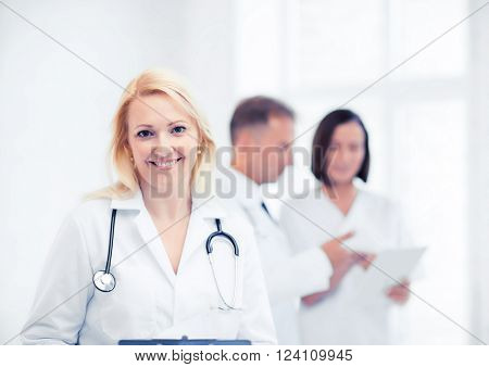 healthcare and medical concept - female doctor with stethoscope