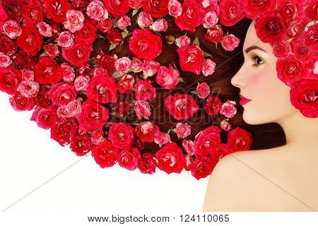 Vintage style profile portrait of young beautiful girl with bright make-up and red roses in her long hair