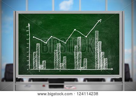 drawing stock chart on green blackboard in office
