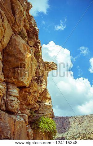 Steep Rocks With Platform Against Sky