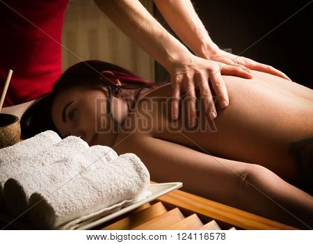 massage therapist at the spa salon makes cellulite massage to a patient. Beauty treatment concept.