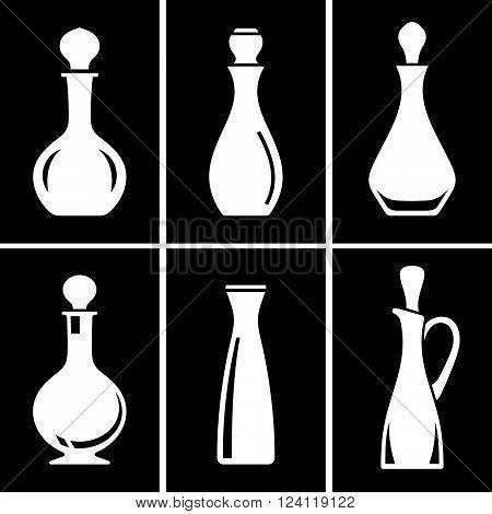 Set of six glass jugs on black background