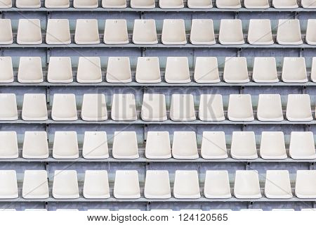 White seats on the tribune of the soccer stadium.