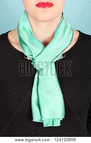 Silk Scarf. Green Silk Scarf Around Her Neck Isolated On Blue Background.